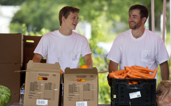 Volunteers load fresh food at the Lowcountry Food Bank, meeting urgent needs in South Carolina.